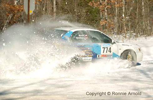 Otis Dimiters and Peter Monin in their Subaru WRX on the Practice Stage